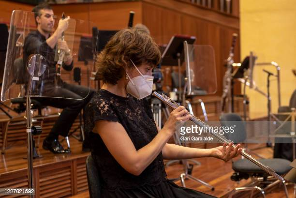 A musician from the Basque Symphony Orchestra prepares her flute before the concert that will be broadcast by public television on May 28 2020 in San...