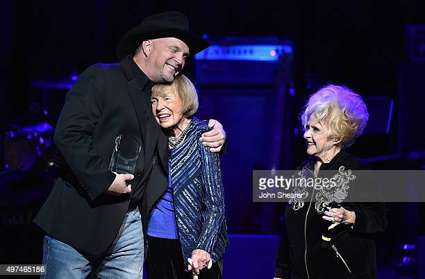Musician Garth Brooks honoree Jo WalkerMeador and singer Brenda Lee on stage at the Leadership Music's Dale Franklin Awards at Country Music Hall of...