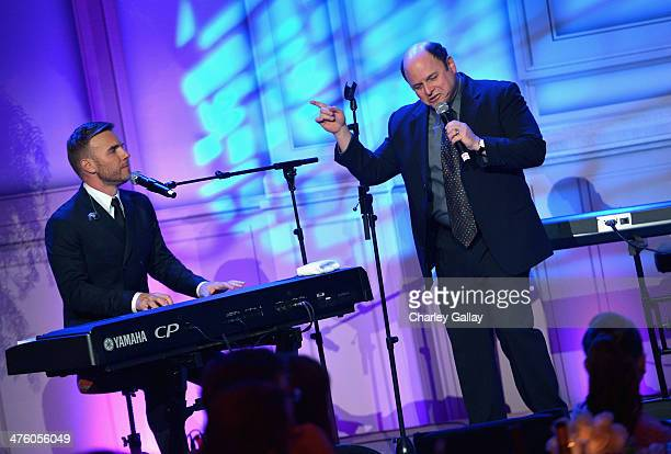 Musician Gary Barlow and actor Jason Alexander perform onstage at The Weinstein Company's Academy Award party hosted by Chopard and DeLeon Tequila at...