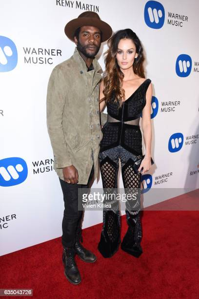 Musician Gary Clark Jr and Model Nicole Trunfio attends the Warner Music Group GRAMMY Party at Milk Studios on February 12 2017 in Hollywood...