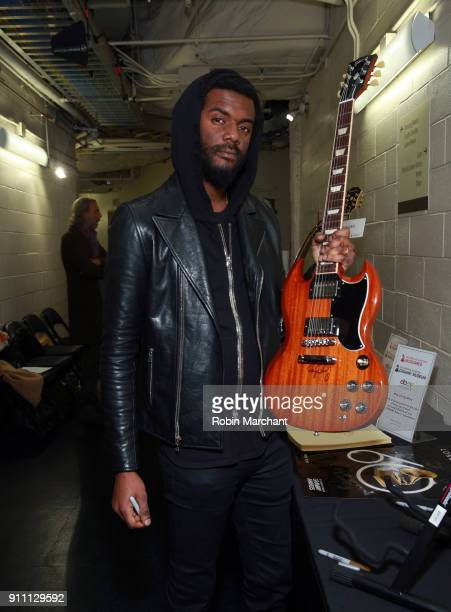 Musician Gary Clark Jr poses with the GRAMMY Charities Signings during the 60th Annual GRAMMY Awards at Madison Square Garden on January 27 2018 in...