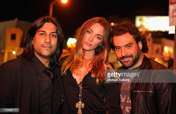 Musician Gaurav Bali model Courtney Bingham and musician Alex Sassaris of the rock group Eve To Adam pose in front of at The Roxy Theatre on June 11...