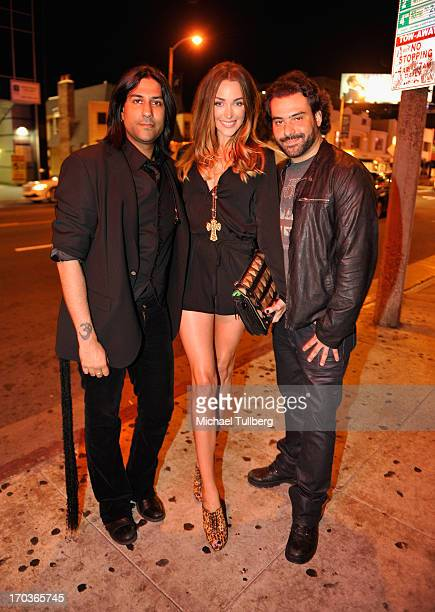 Musician Gaurav Bali model Courtney Bingham and musician Alex Sassaris of the rock group Eve To Adam pose in front of The Roxy Theatre on June 11...