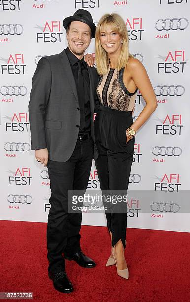 Musician Gavin DeGraw and actress/singer Delta Goodrem arrive at the AFI FEST 2013 premiere of 'Out Of The Furnace' at TCL Chinese Theatre on...