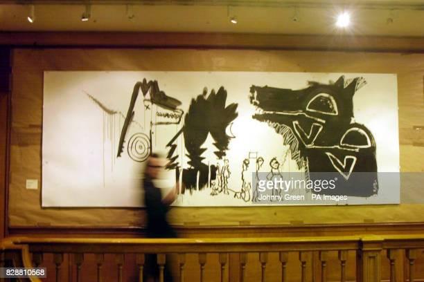 Musician Gavin Friday walks past U2 singer Bono's 'Peter and the Wolf V' illustration inside Christie's in Mayfair London Fifteen original...