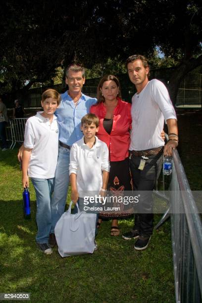 Musician Gavin Rossdale poses with actor Pierce Brosnan his wife Keeley Shaye Smith and their sons Dylan and Paris during the Roots Shoots Day of...