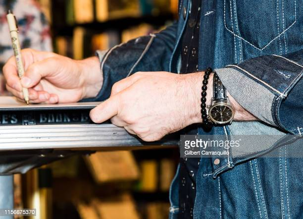 Musician Geddy Lee watch detail signs copies of Geddy Lee's Big Beautiful Book Of Bass at Barnes Noble on July 19 2019 in Philadelphia Pennsylvania