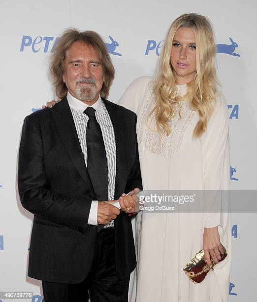 Musician Geezer Butler and singer Kesha arrive at PETA's 35th Anniversary Party at Hollywood Palladium on September 30 2015 in Los Angeles California
