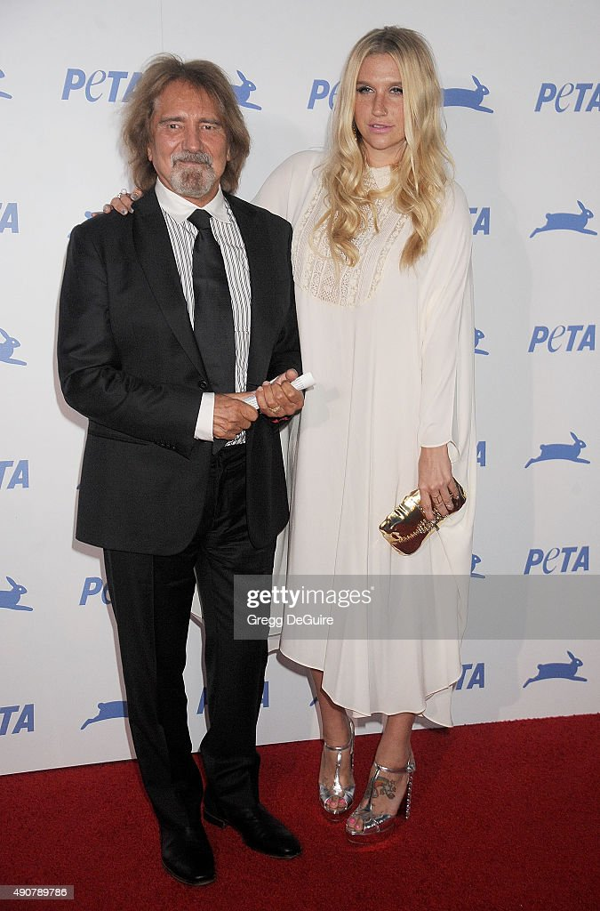 Musician Geezer Butler and singer Kesha arrive at PETA's 35th Anniversary Party at Hollywood Palladium on September 30, 2015 in Los Angeles, California.