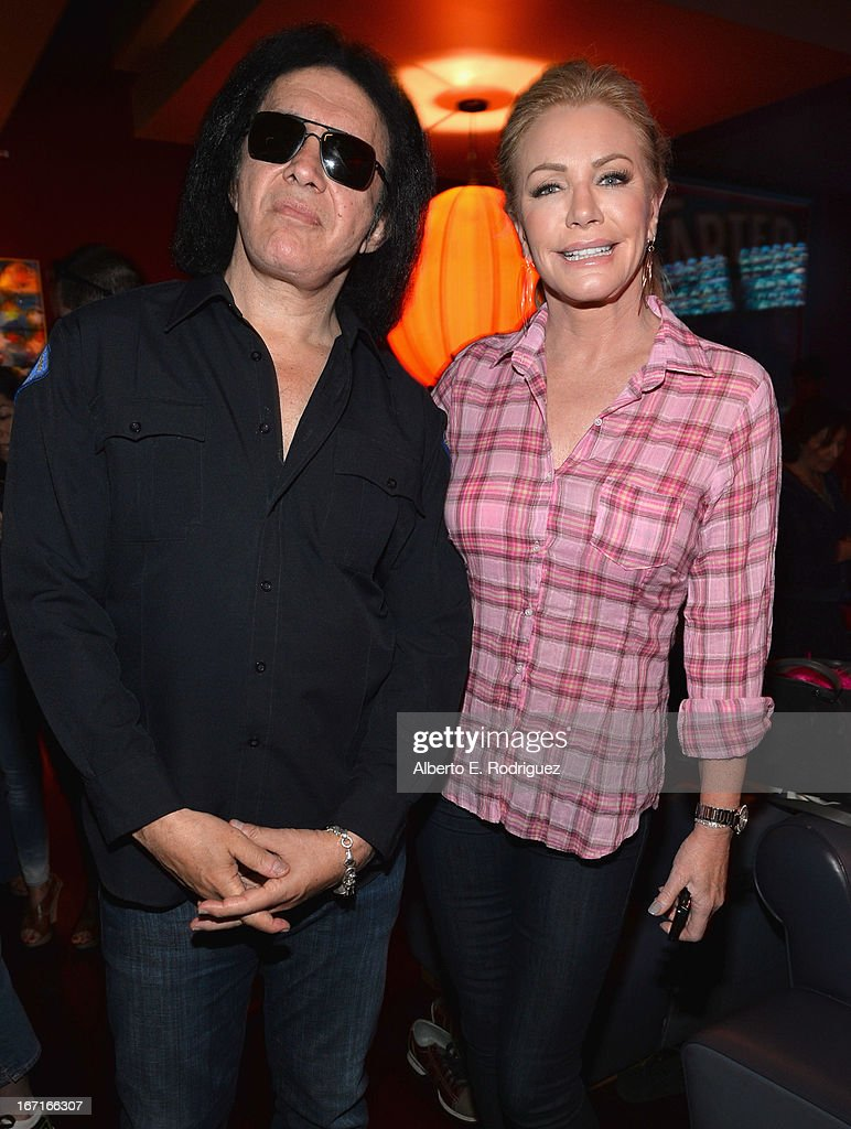 Musician Gene Simmons and actress Shannon Tweed attend the Best Buddies' Bowling For Buddies Event at Lucky Strike Lanes at L.A. Live on April 21, 2013 in Los Angeles, California.