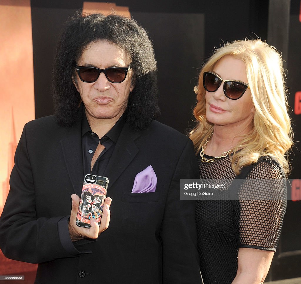 Musician Gene Simmons and Shannon Tweed arrive at the Los Angeles premiere of 'Godzilla' at Dolby Theatre on May 8, 2014 in Hollywood, California.