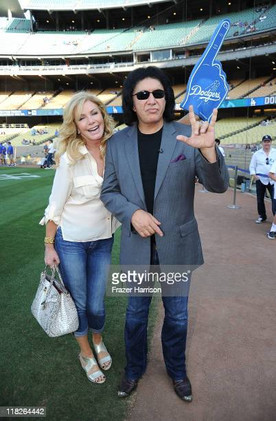 Musician Gene Simmons and Shannon Tweed attend the Dodgers v Mets game to throw out the first pitch of the game at Dodger Stadium on July 5 2011 in...