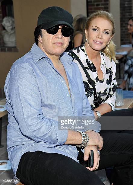 Musician Gene Simmons and Shannon Tweed attend the REVOLVE fashion show benefiting Stand Up To Cancer on October 22 2015 in Los Angeles California