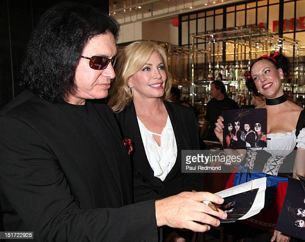 Musician Gene Simmons autographs photos with wife Shannon Tweed at the press conference to announce Rocktoberfest at Wolfgang Puck at LA Live on...
