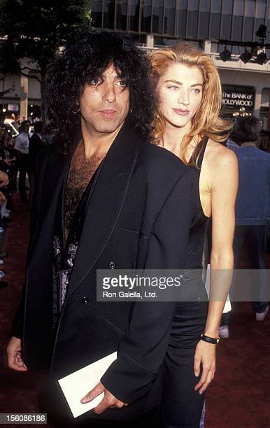 Musician Gene Simmons of Kiss and date Tracy Tweed attending the premiere party for 'Bill Ted's Bogus Journey' on July 11 1991 at the Hollywood...
