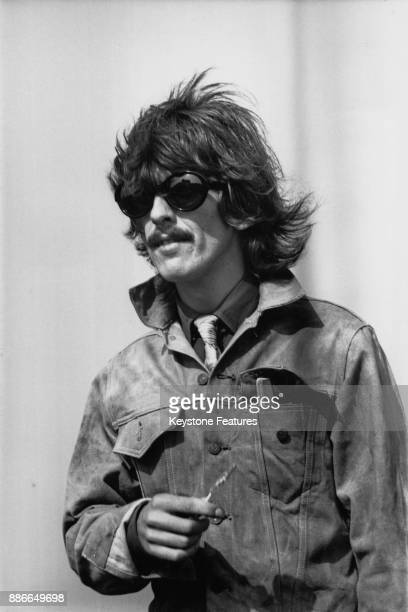 Musician George Harrison of English rock band the Beatles during the filming of 'Magical Mystery Tour' in Newquay UK 1967