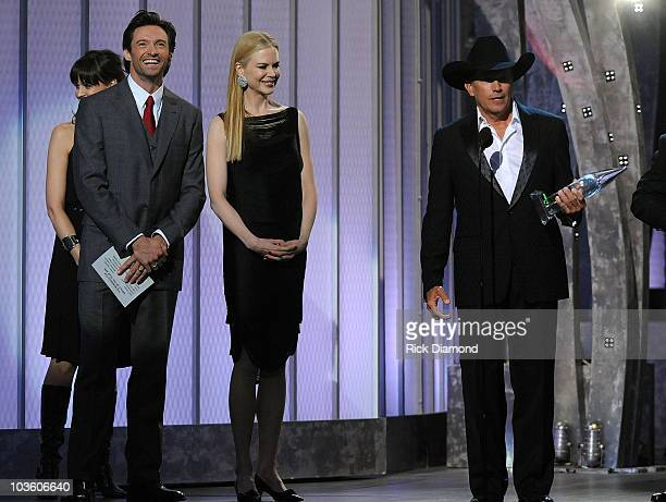 Musician George Strait accepts the award for Single of the year from actors Hugh Jackman and Nicole Kidman on stage during the 42nd Annual CMA Awards...
