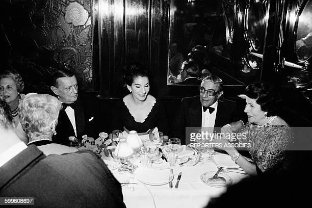 Musician Georges Auric With Maria Callas And Aristote Onassis At Maxim's Restaurant in Paris France in May 1964