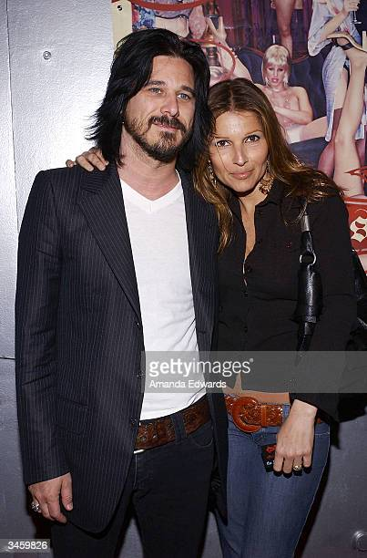Musician Gilby Clark and his wife designer Daniella Clarke arrive at the record release party for Gene Simmons' 'Asshole' on April 22 2004 at the Key...