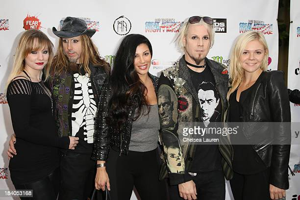 Musician Ginger Fish of Rob Zombie Rita Lowery and musician John 5 of Rob Zombie attend Rob Zombie's Great American Nightmare VIP opening night party...