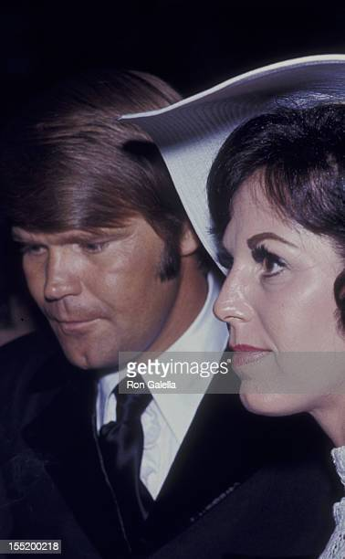 Musician Glen Campbell and Billie Jean Nunley attend Honor America Day on July 4 1970 in Washington DC