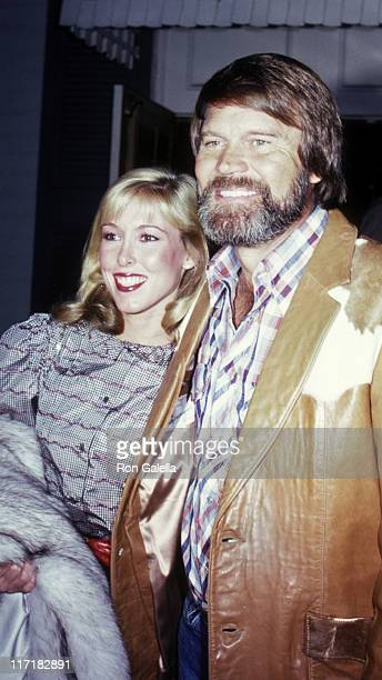 Musician Glen Campbell and Kim Woollen attend Pierre Cossette Super Bowl Party on January 24 1982 at Chasen's Restaurant in Beverly Hills California