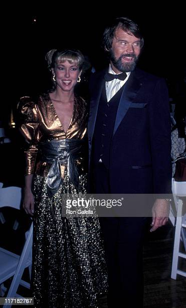 Musician Glen Campbell and Kimberly Woollen attend Nineth Annual American Music Awards on January 25 1982 at the Shrine Auditorium in Los Angeles...