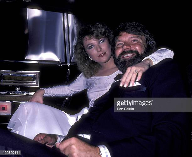 Musician Glen Campbell and Tanya Tucker attend Glen Campbell Golf Tournament Dinner Gala on February 17 1981 at the Century Plaza Hotel in Century...