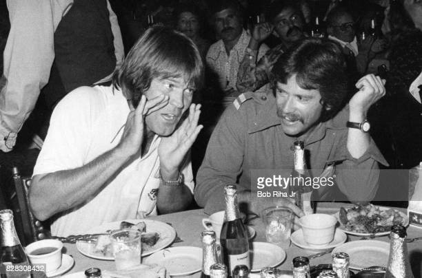 Musician Glen Campbell jokes during dinner time prior to private concert performance with Seals Crofts Doug Kershaw and friends during special...
