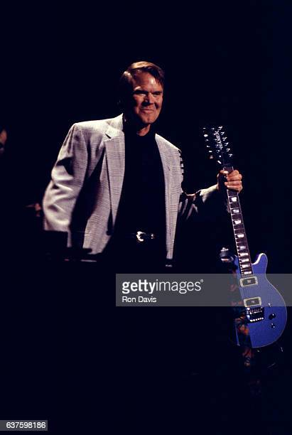 Musician Glen Campbell stands on stage with his guitar during the MCA Records' Rhythm Country Blues concert at the Universal Amphitheatre on March 23...