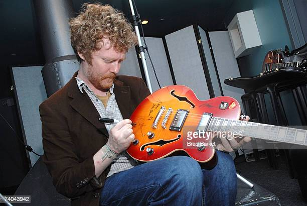 Musician Glen Hansard signs a guitar at the ASCAP Tribeca Music Lounge held at the Canal Room during the 2007 Tribeca Film Festival on May 1 2007 in...
