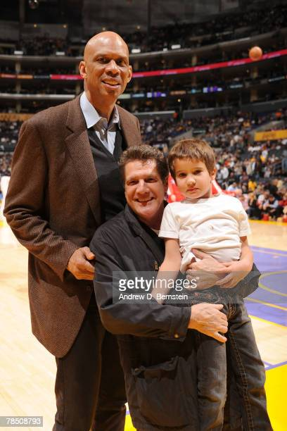 Musician Glenn Frey of the Eagles poses with his son and Kareem AbdulJabbar during the game between the Los Angeles Clippers and the Los Angeles...