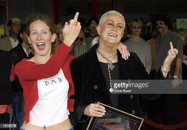 Musician Grace Slick and daughter actress China Kantner give the finger to the media at a handprint ceremony inducting Slick into the Hollywood Rock...
