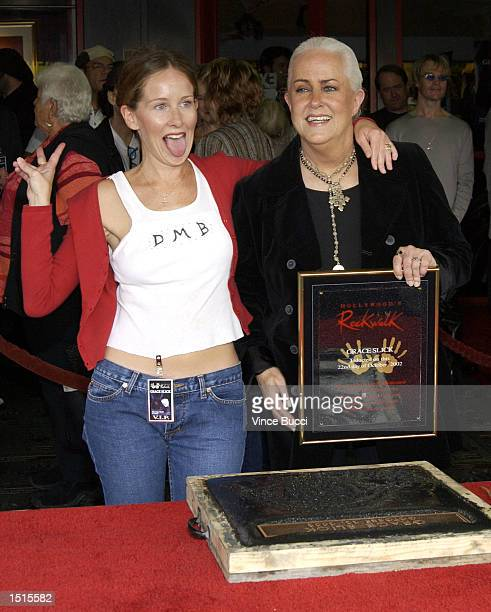 Musician Grace Slick gets a hug from daughter actress China Kantner at a handprint ceremony inducting Slick into the Hollywood Rock Walk at the...