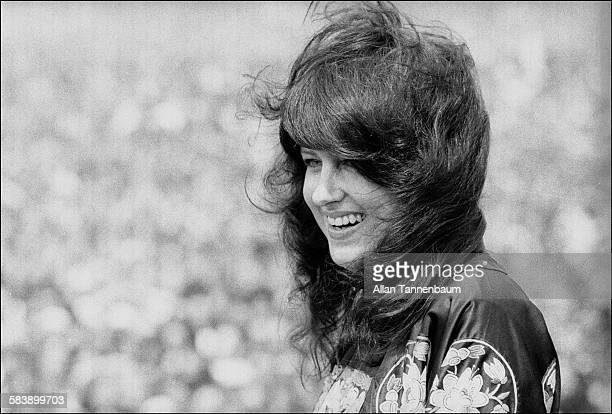 Musician Grace Slick of the band Jefferson Starship smiles during a performance in Central Park New York New York May 1975