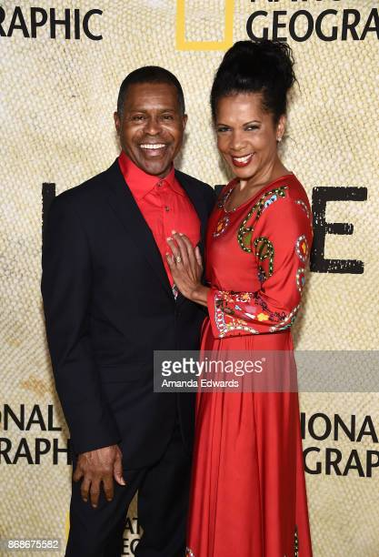 """Musician Gralin Jerald and actress Penny Johnson Jerald arrive at the premiere of National Geographic's """"The Long Road Home"""" at Royce Hall on October..."""