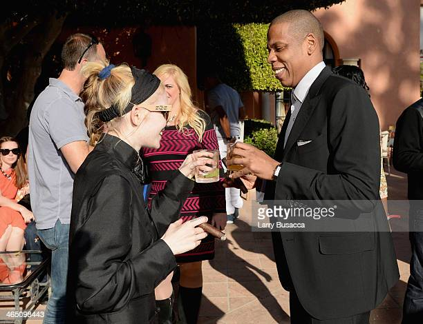 Musician Grimes and rapper/producer JayZ attend the Roc Nation PreGRAMMY Brunch Presented by MAC Viva Glam at Private Residence on January 25 2014 in...
