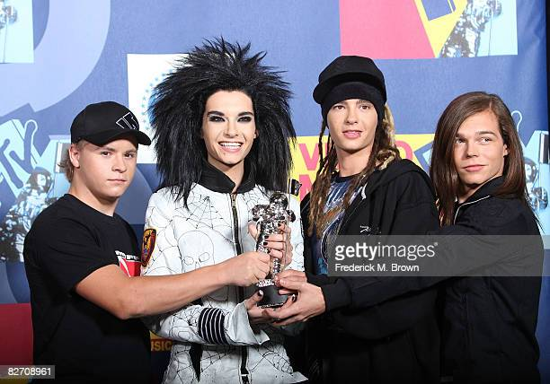 Musician Gustav Schaefer Bill Kaultiz Tom Kaultiz and George Listing of Tokio Hotel pose with their Nest New Artist award in the press room at the...