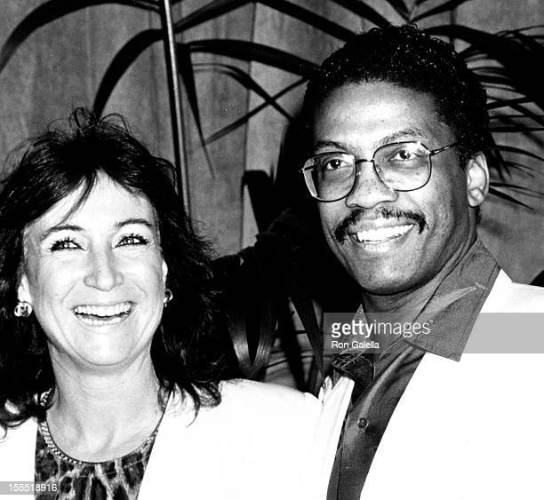 Musician Herbie Hancock and wife Gigi Hancock attend the nominees luncheon for 59th Annual Academy Awards on March 17 1987 at the Beverly Hilton...