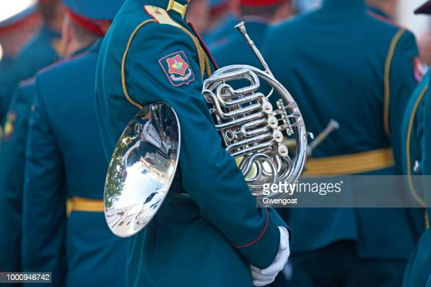 Musician holding his French Horn