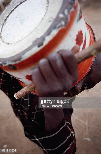 Musician Holding Pot Used as a Drum