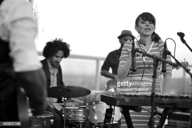 """Musician Holland Greco performs onstage with her band for the Zappa Records release of her album """"Volume 1"""" on the roof of the Andaz Hotel, formerly..."""
