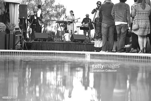 """Musician Holland Greco performs onstage with her band including guitarist Clark Dark at the Zappa Records release of her album """"Volume 1"""" on the roof..."""