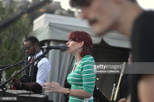 """Musician Holland Greco performs onstage with her band incluidng guitarist Clark Dark at the Zappa Records release of her album """"Volume 1"""" on the roof..."""
