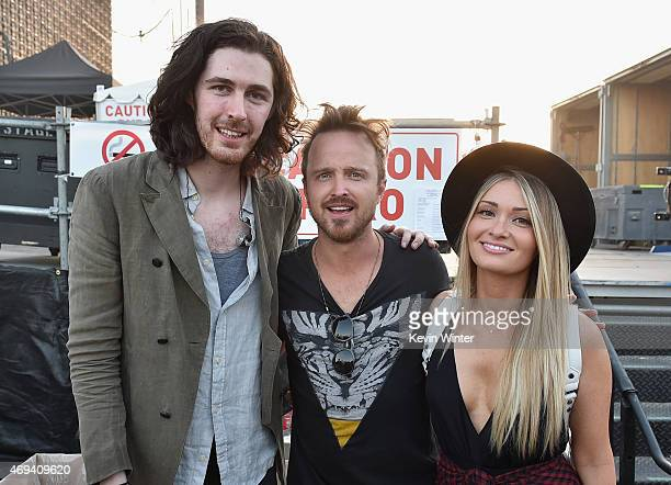 Musician Hozier actor Aaron Paul and Lauren Parsekian attend day 2 of the 2015 Coachella Valley Music Arts Festival at the Empire Polo Club on April...