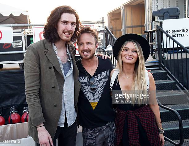 Musician Hozier, actor Aaron Paul and Lauren Parsekian attend day 2 of the 2015 Coachella Valley Music & Arts Festival at the Empire Polo Club on...