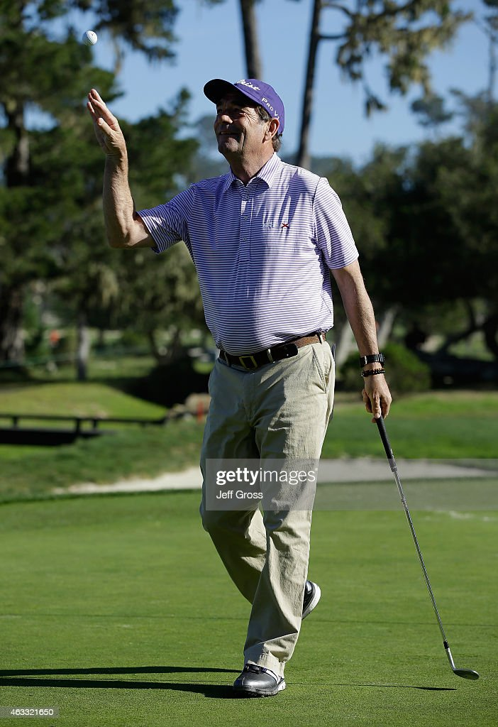 Musician Huey Lewis tosses his golf ball to his caddie during the first round of the AT&T Pebble Beach National Pro-Am at Monterey Peninsula Country Club on February 12, 2015 in Pebble Beach, California.
