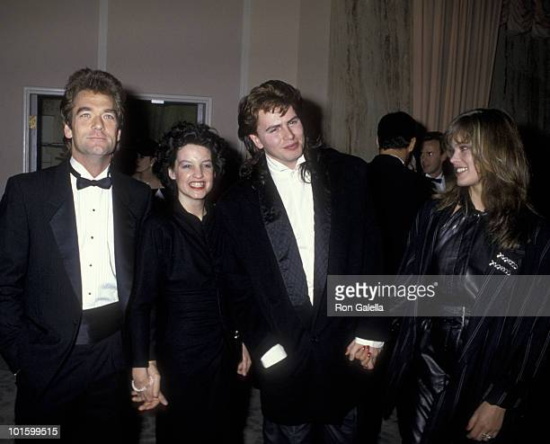 Musician Huey Lewis wife Sidney Conroy musician John Taylor of Duran Duran and model Renee Simonsen attend 43rd Annual Golden Globe Awards on January...