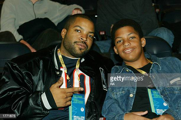 Musician Ice Cube and his son O'Shea enjoy the 989 Sport Skills Challenge at the Georgia Philips Arena during the 2003 NBA All-Star Weekend on...