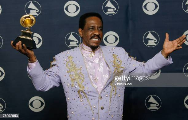 Musician Ike Turner poses with his Grammy for Best Traditional Blues Album for 'Risin' With The Blues' in the press room at the 49th Annual Grammy...